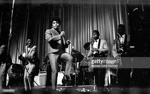 'Godfather of Soul' James Brown performs with The Famous Flames at the Apollo Theater in 1964 in New York New York