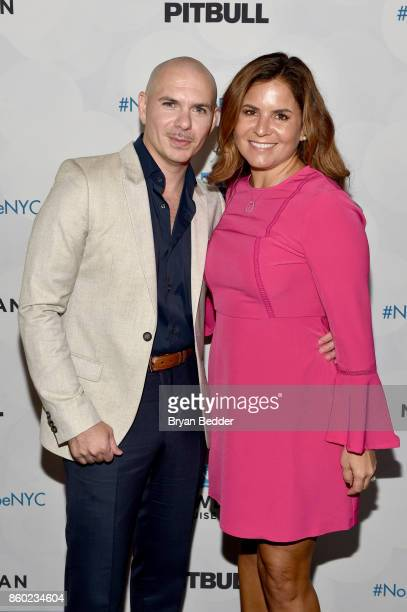 Godfather Pitbull and Godmother of Norwegian Gem 2007 Cindy Cardella attend Norwegian Escape heads to NYC event at PHD at the Dream Downtown on...