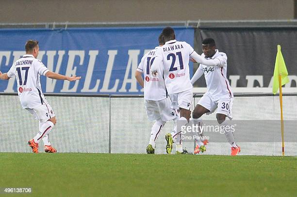 Godfred Donsa of Bologna FC celebrate wit his team mate's after scoring his team's second goal during the Serie A match between Hellas Verona FC and...