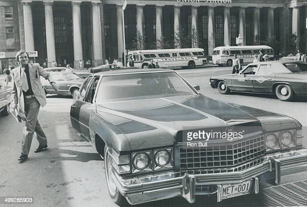 Godfrey and 'bus' arrive for strike talks Arriving today at the Royal York Hotel where the negotiations in the transit strike are being conducted...