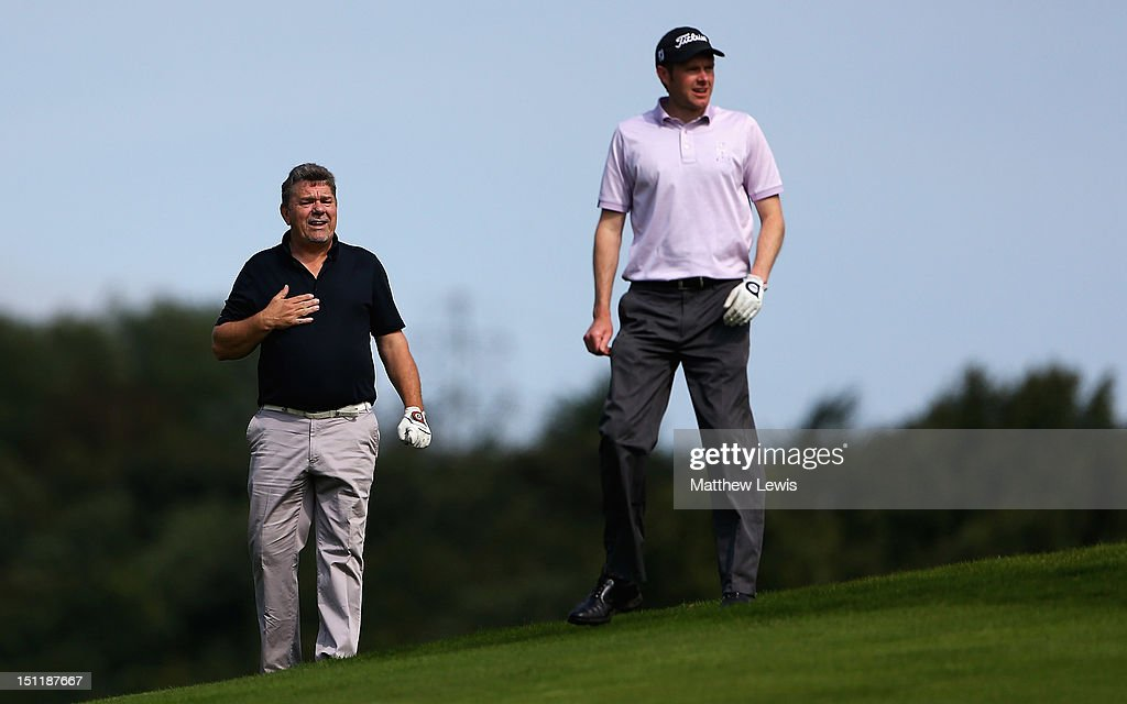 Godfrey Fisher and Andrew Turner of Knaresborough Golf Club look on during the Lombard Challenge Regional Qualifier at Huddersfield Golf Club on September 3, 2012 in Huddersfield, England.
