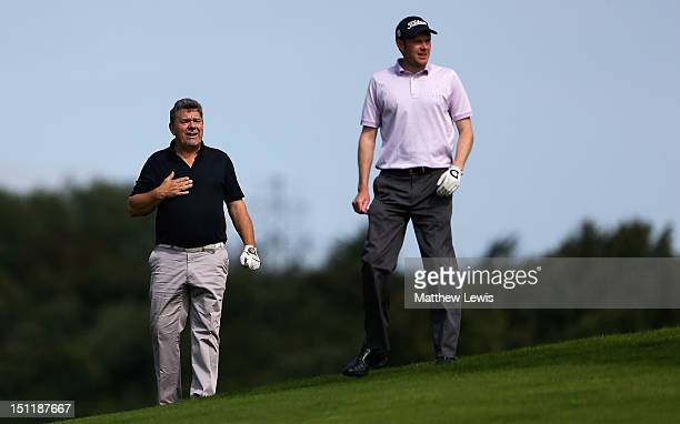 Godfrey Fisher and Andrew Turner of Knaresborough Golf Club look on during the Lombard Challenge Regional Qualifier at Huddersfield Golf Club on...