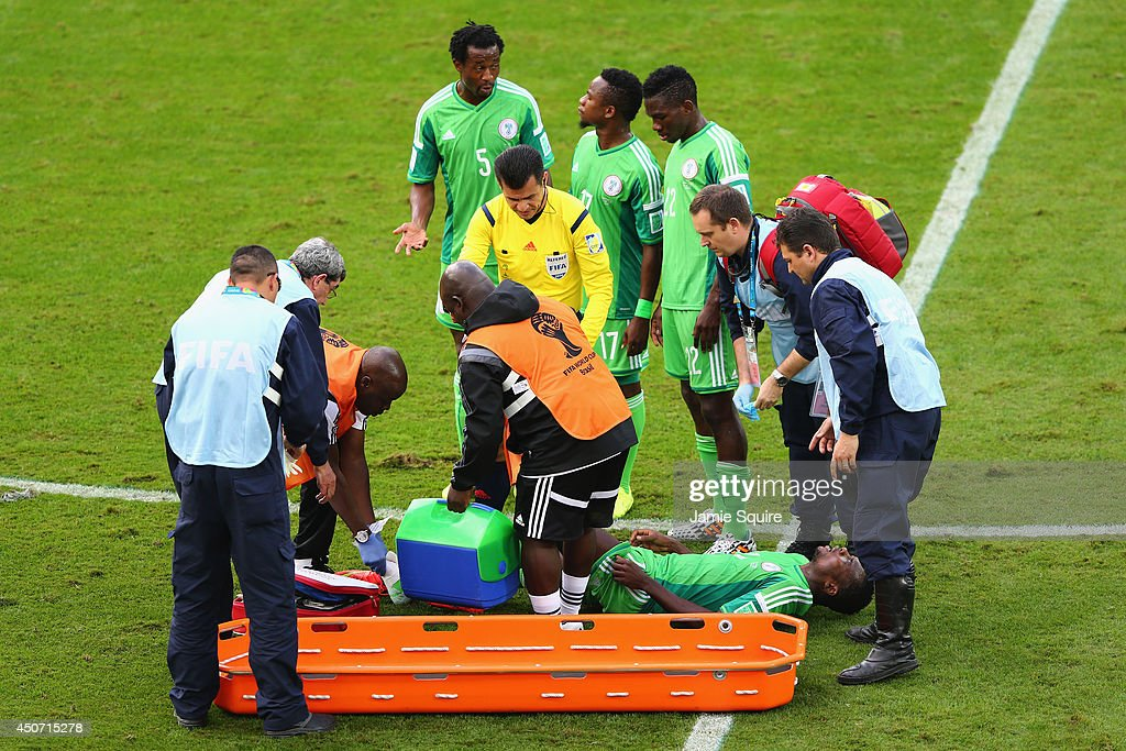 <a gi-track='captionPersonalityLinkClicked' href=/galleries/search?phrase=Godfrey+Oboabona&family=editorial&specificpeople=9435105 ng-click='$event.stopPropagation()'>Godfrey Oboabona</a> of Nigeria is treated on the sideline during the 2014 FIFA World Cup Brazil Group F match between Iran and Nigeria at Arena da Baixada on June 16, 2014 in Curitiba, Brazil.