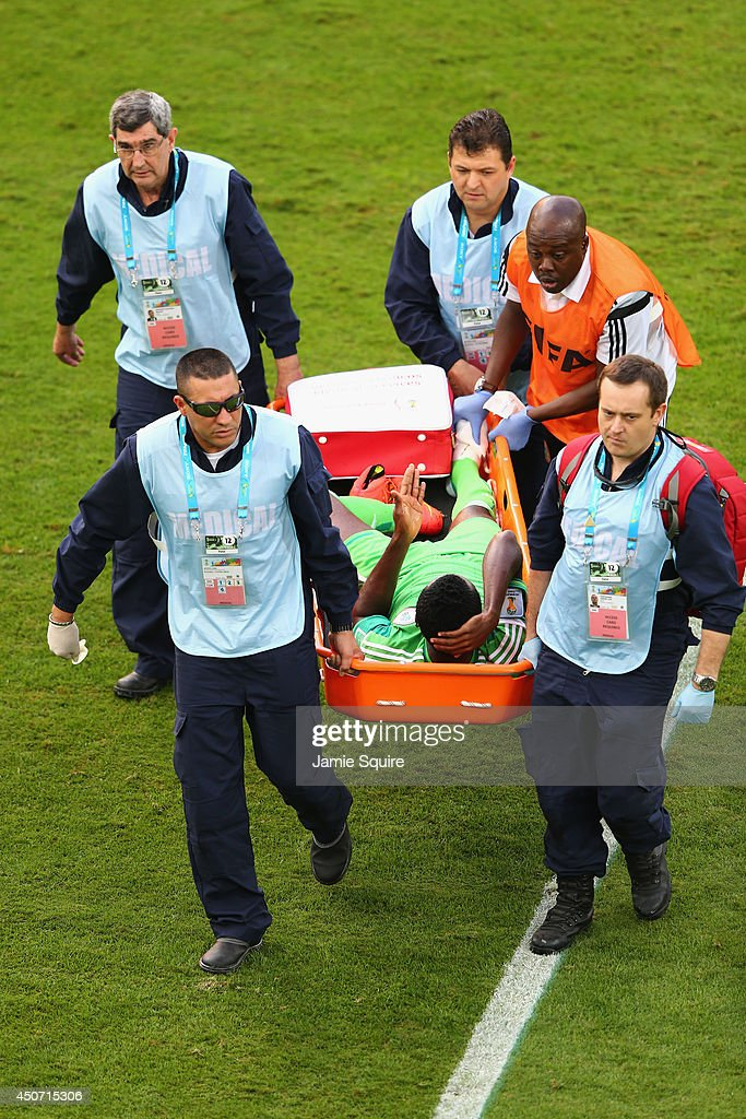 <a gi-track='captionPersonalityLinkClicked' href=/galleries/search?phrase=Godfrey+Oboabona&family=editorial&specificpeople=9435105 ng-click='$event.stopPropagation()'>Godfrey Oboabona</a> of Nigeriais stretchered off the field during the 2014 FIFA World Cup Brazil Group F match between Iran and Nigeria at Arena da Baixada on June 16, 2014 in Curitiba, Brazil.