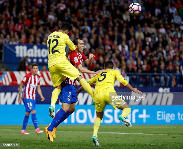 Godinof Atletico Madrid Alvaro of Villarreal and Musacchio of Villarreal battle for the ball during the La Liga match between Club Atletico de Madrid...