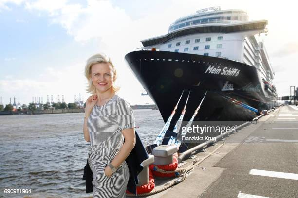Godmother Iveta Apkalna wearing an outfit by Max Mara poses in front of the cruise ship 'Mein Schiff 6' on May 31 2017 in Hamburg Germany