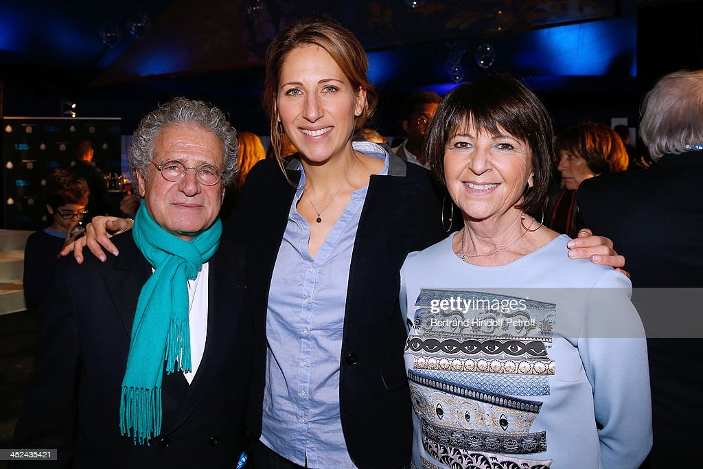 Godmother of One Drop France Maud Fontenoy standing between CEO One Drop France Laurent Dassault and his wife Martine Dassault attend the 'One Drop' Gala, held at Cirque du Soleil on November 28, 2013 in Paris, France.