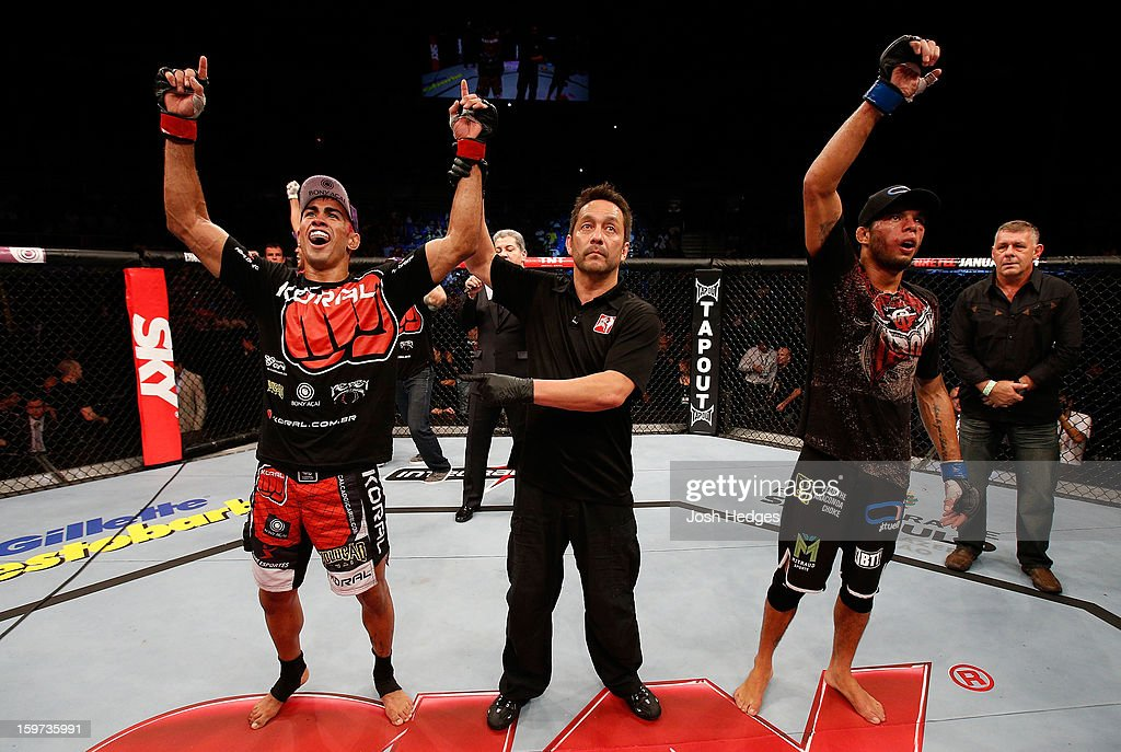Godofredo 'Pepey' Castro (L) reacts after winning a split decision over Milton Vieira (R) in their featherweight fight at the UFC on FX event on January 19, 2013 at Ibirapuera Gymnasium in Sao Paulo, Brazil.