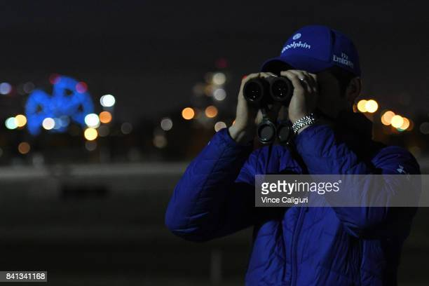 Godolphin trainer James Cummings is seen clocking horses during a trackwork session on the first day of Spring at Flemington Racecourse on September...