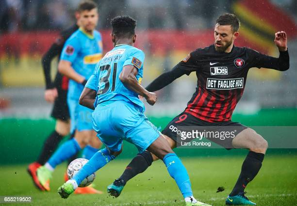 Godsway Donyoh of FC Nordsjalland and Janus Drachmann of FC Midtjylland compete for the ball during the Danish Alka Superliga match between FC...