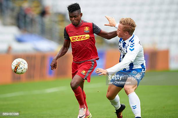Godsway Donyoh of FC Nordsjalland and Jeppe Tverskov of OB Odense compete for the ball during the Danish Alka Superliga match between OB Odense and...
