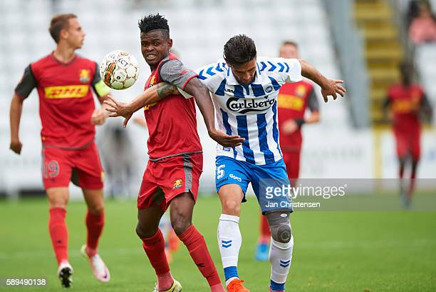 Godsway Donyoh of FC Nordsjalland and Joao Pereira of OB Odense compete for the ball during the Danish Alka Superliga match between OB Odense and FC...