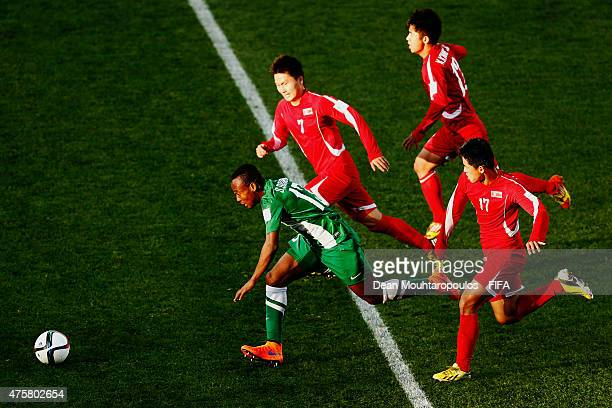 Godwin Saviour of Nigeria gets past Ri Kyong Jin Kim Kwang Jin and Kang Nam Gwon of Korea DPR during the FIFA U20 World Cup New Zealand 2015 Group E...