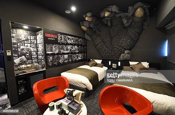 A Godzilla paw and posters of related movies are seen at the 'Gozilla Room' of Hotel Gracery Shinjuku at Kabukicho shopping district in Tokyo on...