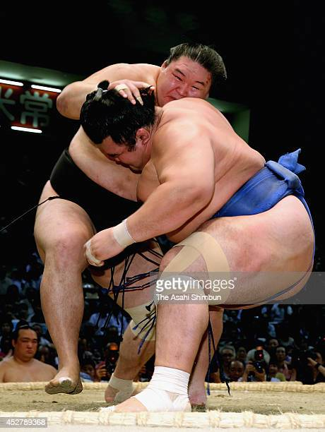 Goeido and ozeki Kotoshogiku compete during day fifteen of the Grand Sumo Nagoya Tournament at Aichi Prefecture Gymnasium on July 27 2014 in Nagoya...