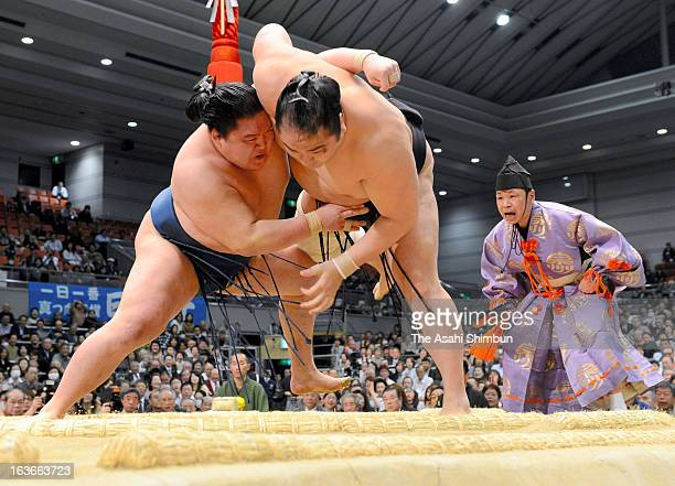 Goeido pushes out Aminishiki during day four of the Grand Sumo Spring Tournament at Osaka Prefectural Gymnasium on March 13 2013 in Osaka Japan