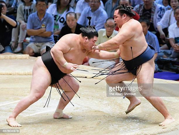 Goeido pushes out yokozuna Kakuryu during day ten of the Grand Sumo Nagoya Tournament at Aichi Prefecture Gymnasium on July 22 2014 in Nagoya Aichi...