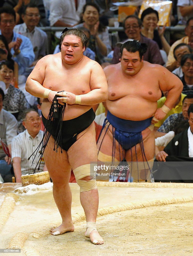 Goeido reacts after beating ozeki Kotoshogiku during day fifteen of the Grand Sumo Nagoya Tournament at Aichi Prefecture Gymnasium on July 27 2014 in...