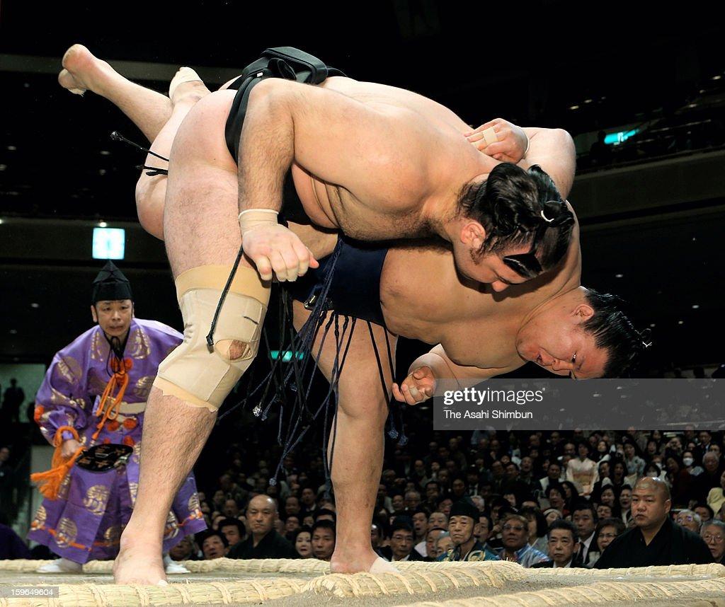 Goeido (R) throws Kotooshu to win in day five of the Grand Sumo New Year Tournament at Ryogoku Kokugikan on January 17, 2013 in Tokyo, Japan.