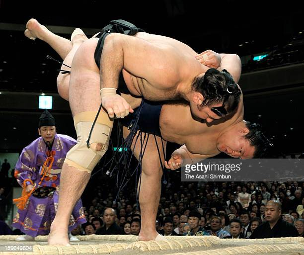 Goeido throws Kotooshu to win in day five of the Grand Sumo New Year Tournament at Ryogoku Kokugikan on January 17 2013 in Tokyo Japan