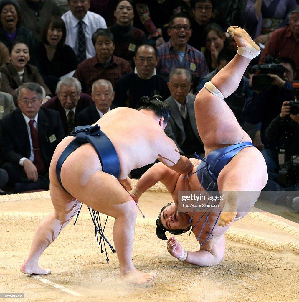 Goeido (L) throws Ozeki Kotoshogiku to win during day fifteen of the Grand Sumo November Tournament at Fukuoka Convention Center on November 25, 2012 in Fukuoka, Japan.
