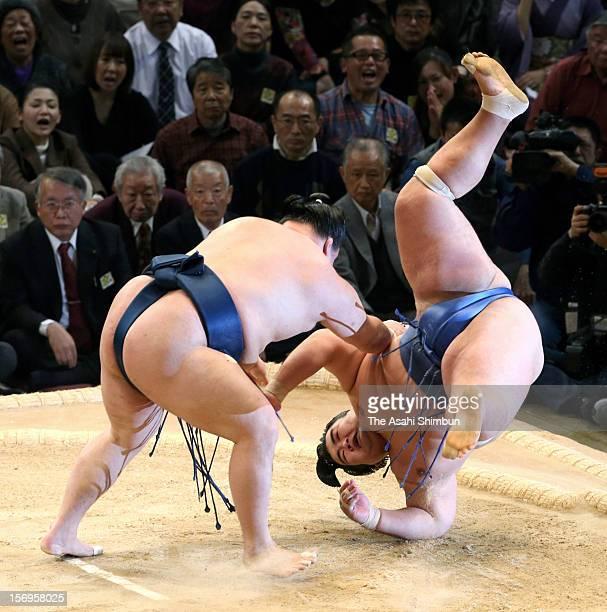 Goeido throws Ozeki Kotoshogiku to win during day fifteen of the Grand Sumo November Tournament at Fukuoka Convention Center on November 25 2012 in...