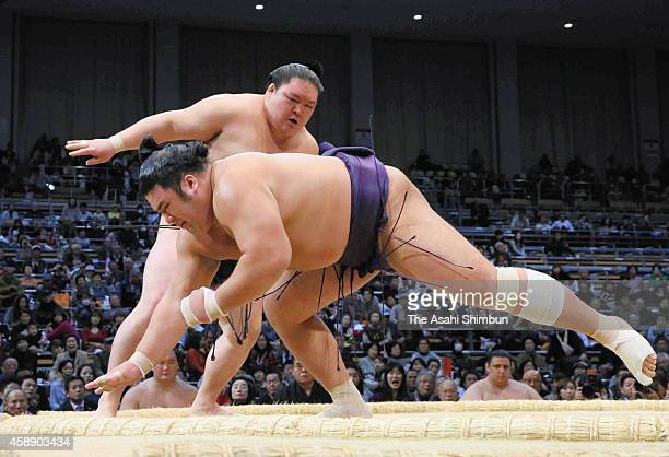 Goeido throws Tochiozan to win during day five of the Grand Sumo Kyushu Tournament at Fukuoka Covention Center on November 13 2014 in Fukuoka Japan
