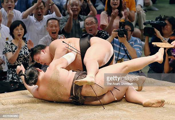 Goeido throws yokozuna Hakuho to win during day eleven of the Grand Sumo Nagoya Tournament at Aichi Prefecture Gymnasium on July 23 2014 in Nagoya...