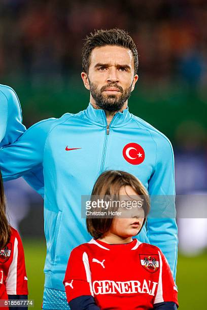 Goekhan Goenuel of Turkey lines up during the national anthem prior to the international friendly match between Austria and Turkey at...