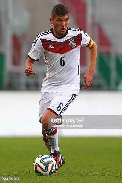 Goekhan Guel of Germany runs with the ball during the KOMM MIT tournament match between U17 Germany and U17 Netherlands at Audi Sportpark on...