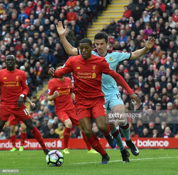 Goerginio Wijnaldum of Liverpool with Joey Barton of Burnleyduring the Premier League match between Liverpool and Burnley at Anfield on March 12 2017...