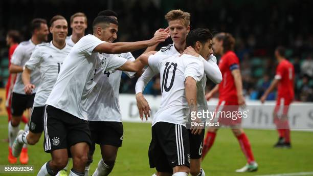 Goerkem Saglam of Germany celebrates with teammates after his first goal during the international friendly U20 match between U20 Germany and U20...