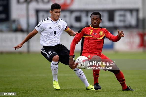 Goerkem Saglam of Germany challenges Joel KalonjiKalonji of Belgium during the Under 16 Juniors International Friendly match between U16 Belgium and...
