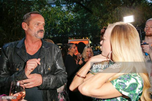 Goetz Elbertzhagen and German actress Jenny Elvers during the 'True Berlin' Hosted By Shan Rahimkhan on July 11 2017 in Berlin Germany