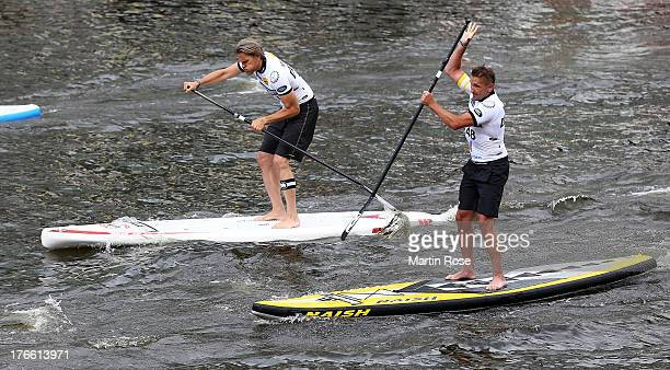 Goetz Otto and Mark Keller german actors compete during the Stand Up Paddling celebrity race at Magellan Terassen on August 16 2013 in Hamburg Germany