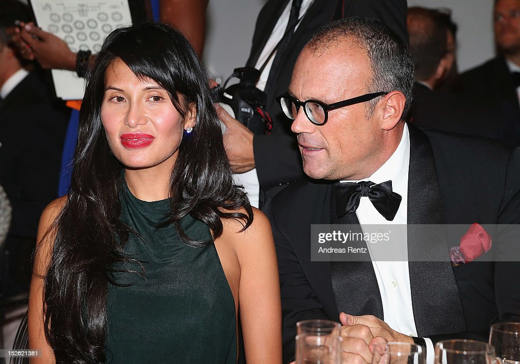 Goga Ashkenazi and Cesare Cunaccia attend the amfAR Milano 2012 Dinner during Milan Fashion Week at La Permanente on September 22 2012 in Milan Italy