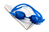 goggles and cap for swimming on a white background