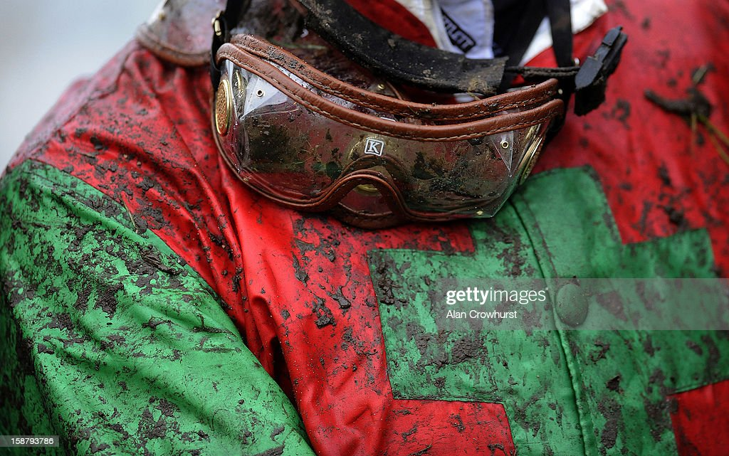 Goggles and jacket are cover with mud at Newbury racecourse on December 29, 2012 in Newbury, England.