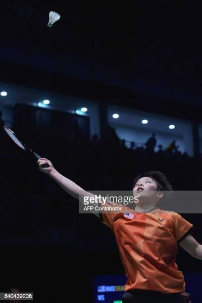 Goh Jin Wei of Malaysia hits a return against Soniia Cheah of Malaysia during the women's singles badminton final at the 29th Southeast Asian Games...