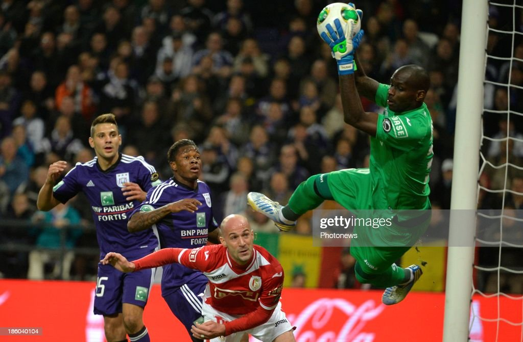 Gohi Bi Zoro Cyriac of Rsc Anderlecht - Laurent Ciman of Standard Liege - Yohann Thuram of Standard Liege during the Jupiler League match between RSC Anderlecht and Standard Liege on October 27, 2013 in Anderlecht, Belgium.