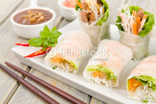 Goi cuon rolls on white plate with sauces and chopsticks : Stock Photo