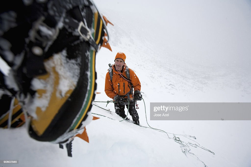 Going ice climbing, two men mountaineer on the steep headwall of the glacial cirque of Tuckerman's R