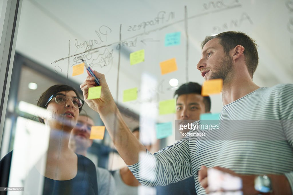 Going over the plan : Stock Photo
