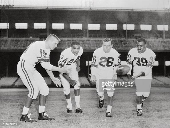 Going through early morning drill in rain here 1/10 at Wrigley Field the backfield for the allstars from the west left to right John Unitas Baltimore...