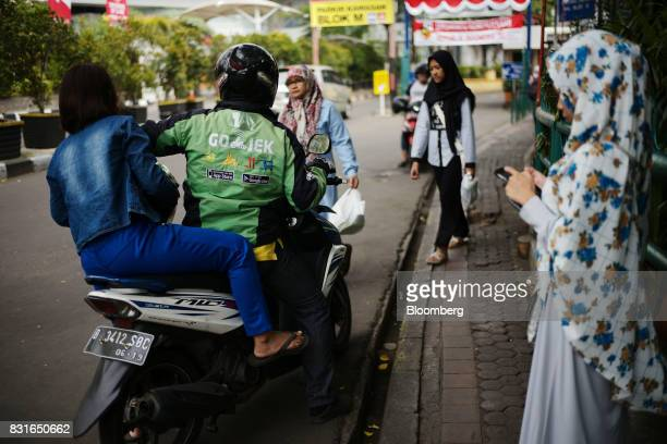 A GoJek motorcycle driver drops off a passenger in Jakarta Indonesia on Sunday Aug 13 2017 President Joko Widodo is seeking hundreds of billions of...