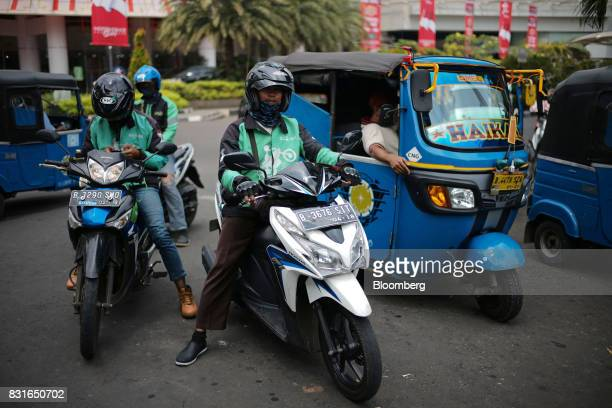 GoJek motorcycle drivers and bajaj drivers wait for fares in Jakarta Indonesia on Sunday Aug 13 2017 President Joko Widodo is seeking hundreds of...