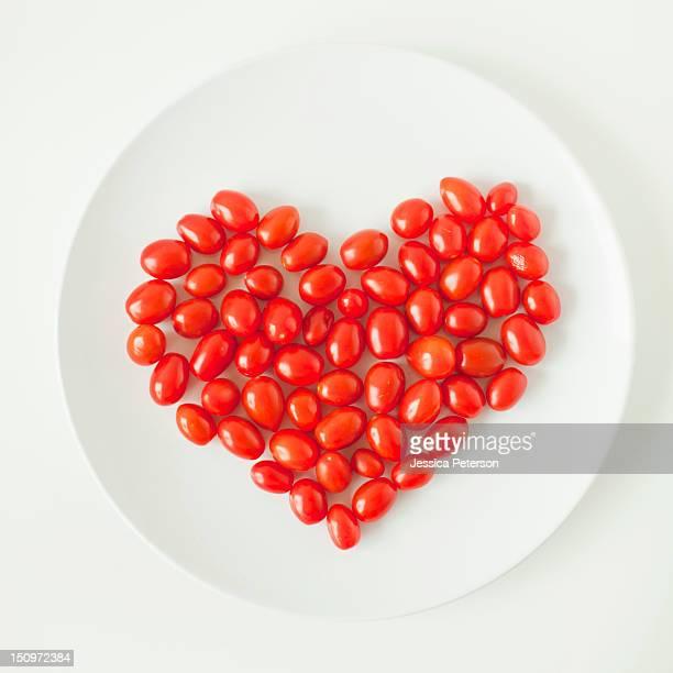 Goji berry heart on plate, studio shot