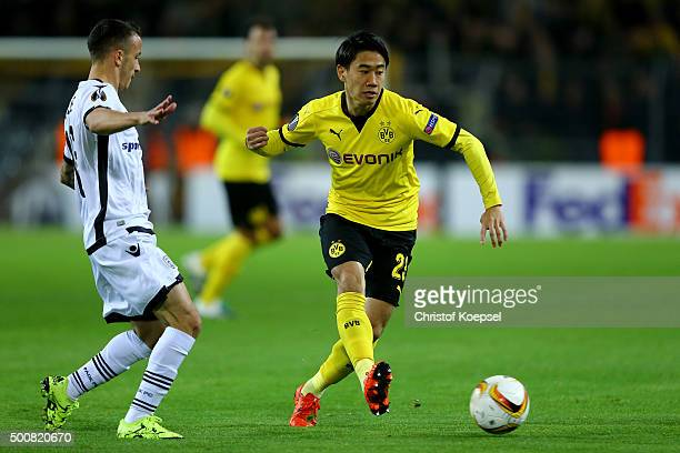 Gojko Cimirot of PAOK FC challenges Shinji Kagawa of Dortmund during the UEFA Europa League group C match between Borussia Dortmund and PAOK FC at...