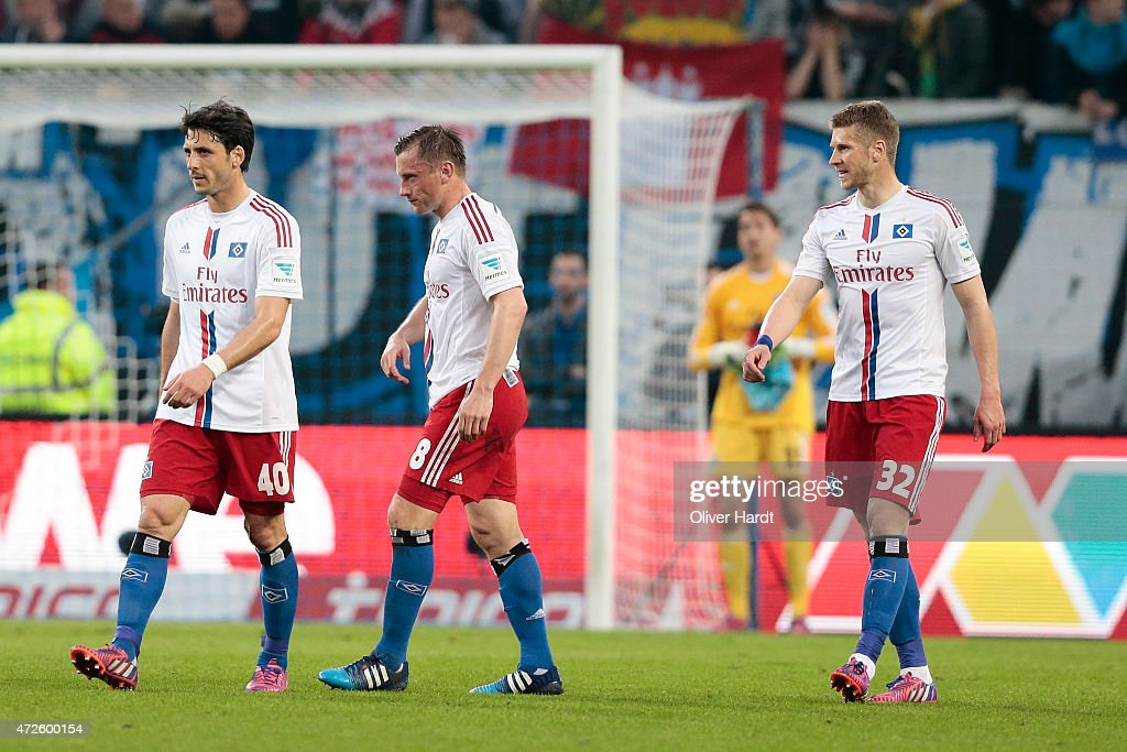 Gojko Kacar, Ivica Olic and Slobodan Rajkovic (L-R) of Hamburg appears frustrated during the First Bundesliga match between Hamburger SV and SC Freiburg at Imtech Arena on May 8, 2015 in Hamburg, Germany.