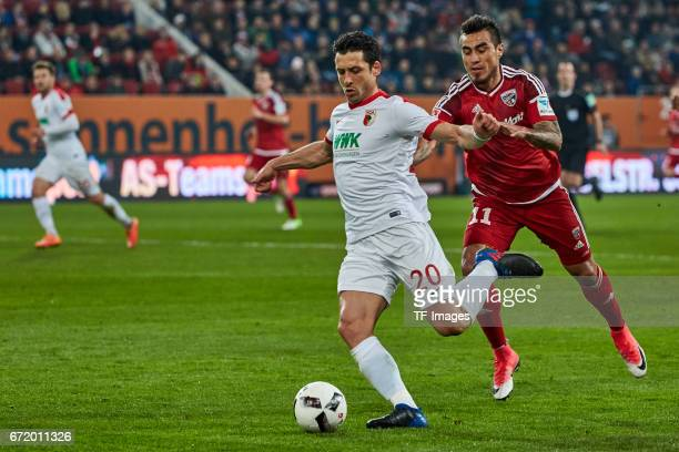 Gojko Kacar of Augsburg and Dario Lezcano of Ingolstadt battle for the ball during the Bundesliga match between FC Augsburg and FC Ingolstadt 04 at...